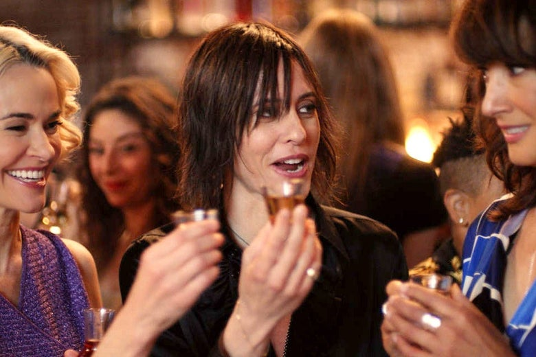 Leisha Hailey, Katherine Moennig, and Jennifer Beals taking shots in a scene from the show.