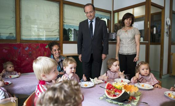France's President Francois Hollande visits the créche of the Elysee Palace in Paris.