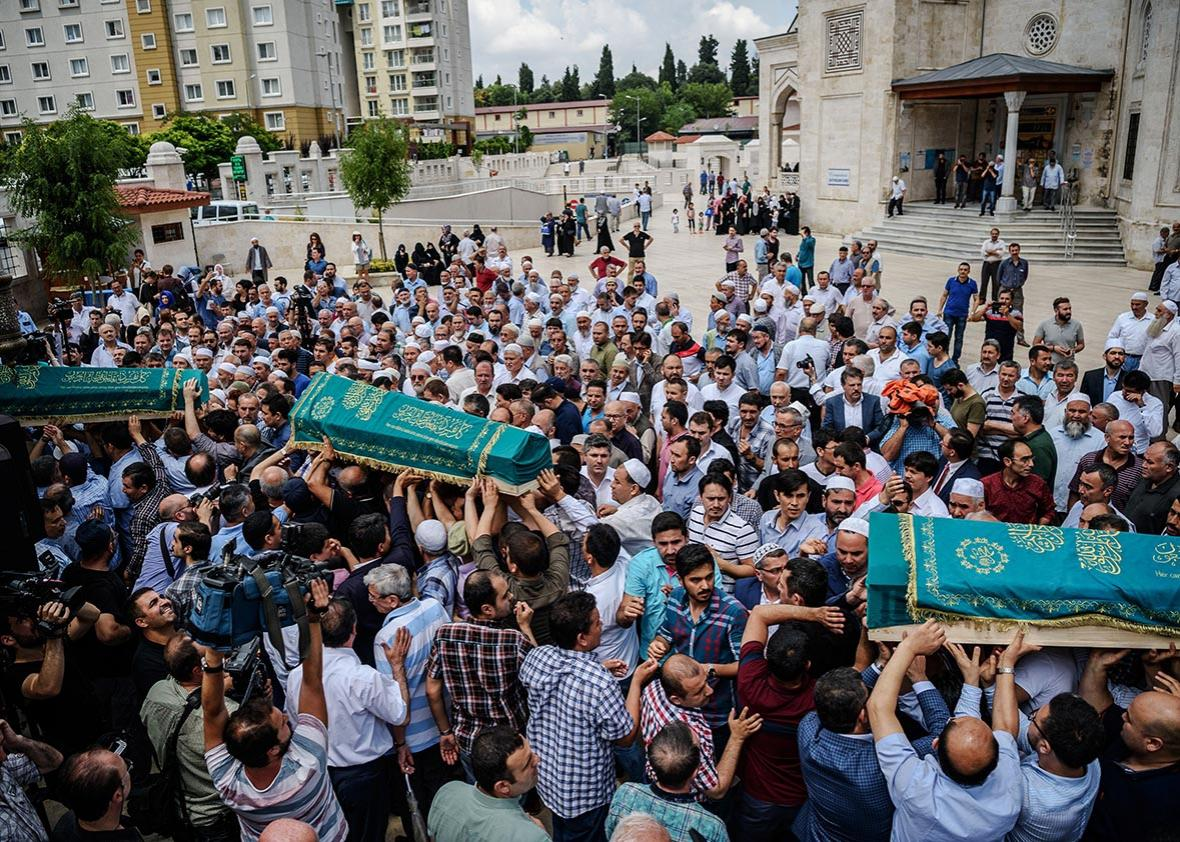 People carry the coffins of Maryam Amiri, Karime Amiri, Zahra Amiri and Huda Amiri on June 30, 2016 during their funerals two days after they were killed by a suicide bombing and gun attack targeted Istanbul's Ataturk airport, killing 42 people.
