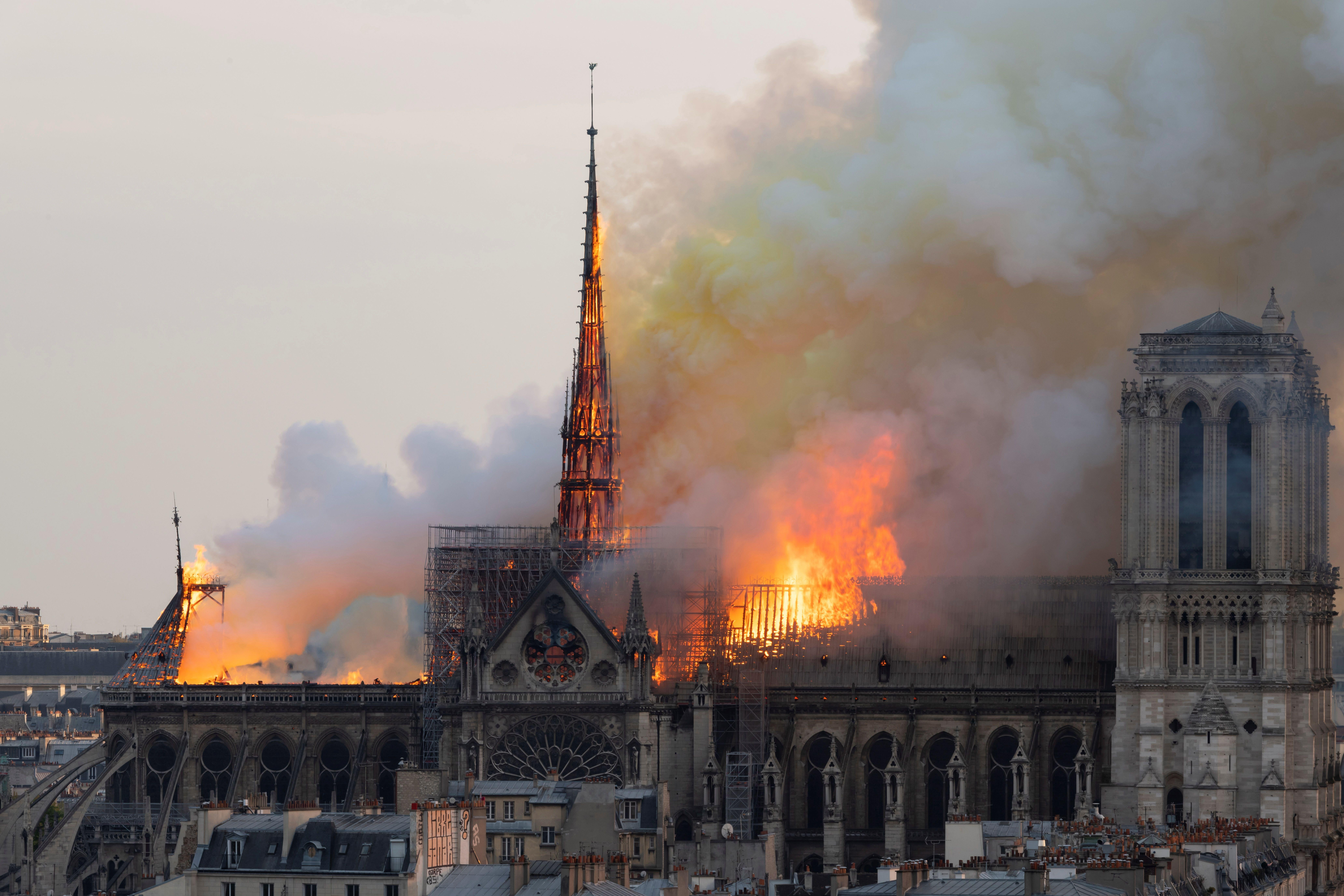 Smoke billows and flames rise from the roof of the Notre-Dame Cathedral.