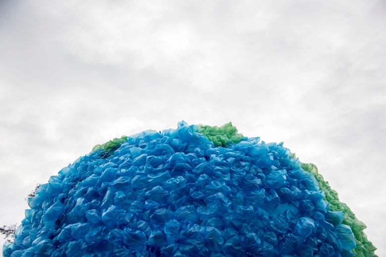 View of a sphere made out of plastic bags that simulates the contaminated earth during the launching of the 'Zero Percent Plastic' ecological campaign to reduce the use of plastic bags in Chile, in Santiago, on June 8, 2017.          On average, each Chilean uses 500 plastic bags a year, that is, 1.5 bags per day, according to WWF Chile (World Wide Fund for Nature). / AFP PHOTO / Martin BERNETTI        (Photo credit should read MARTIN BERNETTI/AFP/Getty Images)