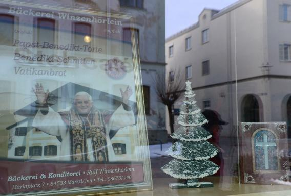 A picture of Pope Benedict XVI is seen behind a window of a bakery in the village Marktl, the birthplace of Pope Benedict XVI.