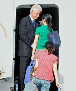 Bill Clinton with Laura Ling (in green) and Euna Lee (in red). Click image to expand.
