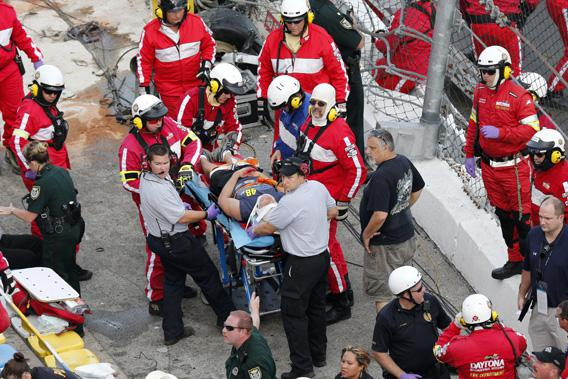 Rescue workers attend to the injured in the stands following a last-lap incident.