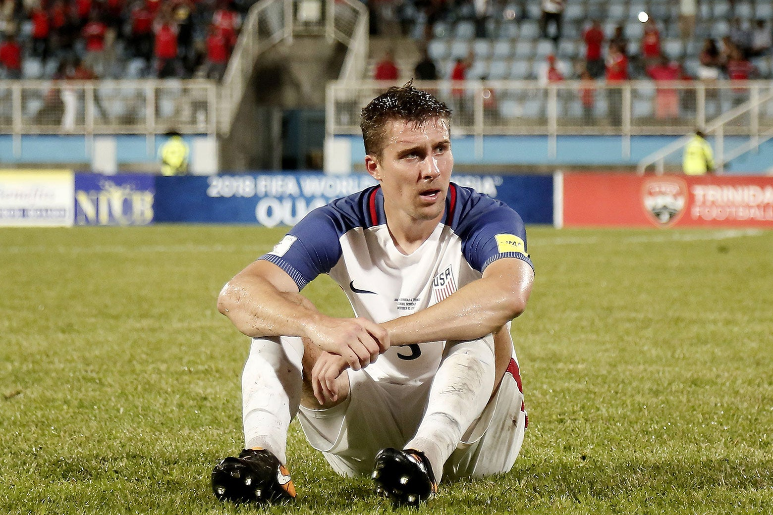 USA's Matt Besler sits on the field in dejection after losing to Trinidad and Tobago 2–1 in a qualifier match on Oct. 10.