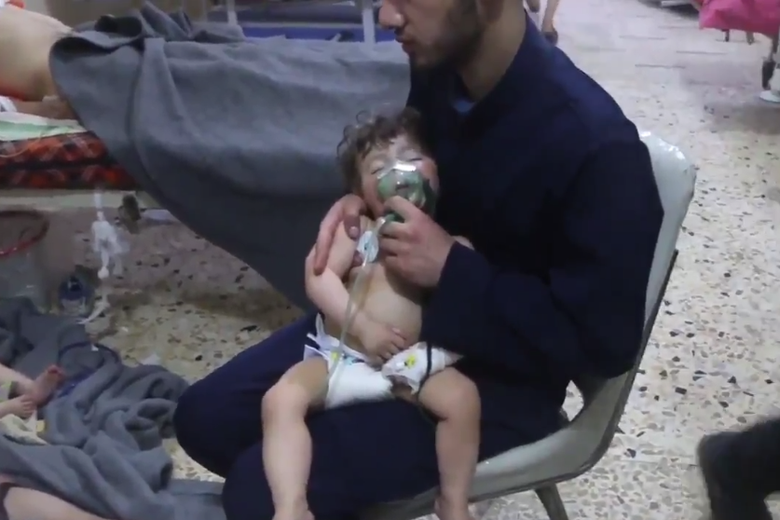 This screenshot from video released by the Syrian Civil Defense, known as the White Helmets, reportedly shows medical workers treating toddlers following the alleged chemical town in Douma, in eastern Ghouta, near Damascus, Syria.