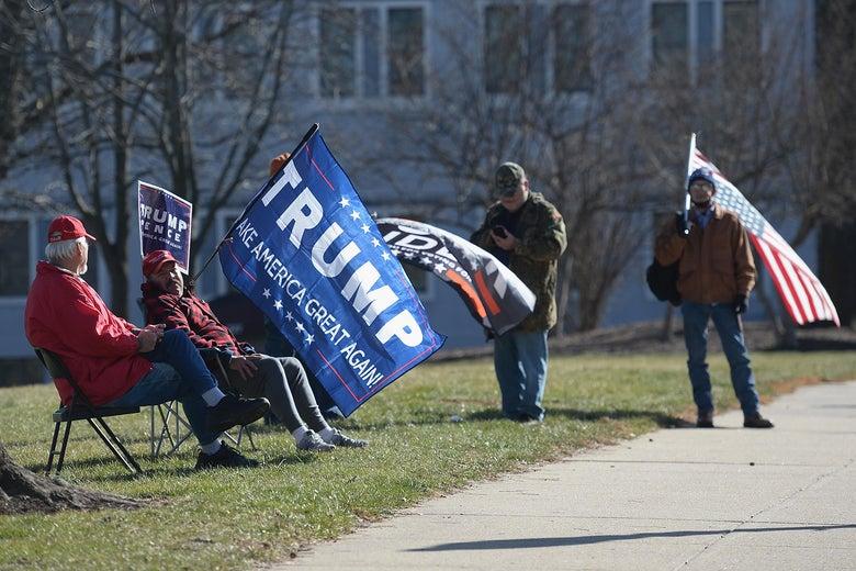 Pro-Trump protestors sitting in folding chairs.