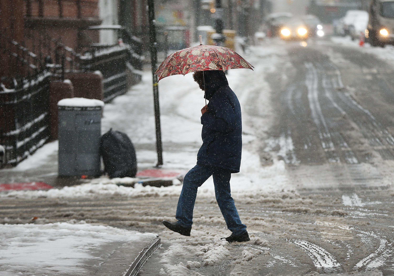 Pedestrian walking on a snowy day.