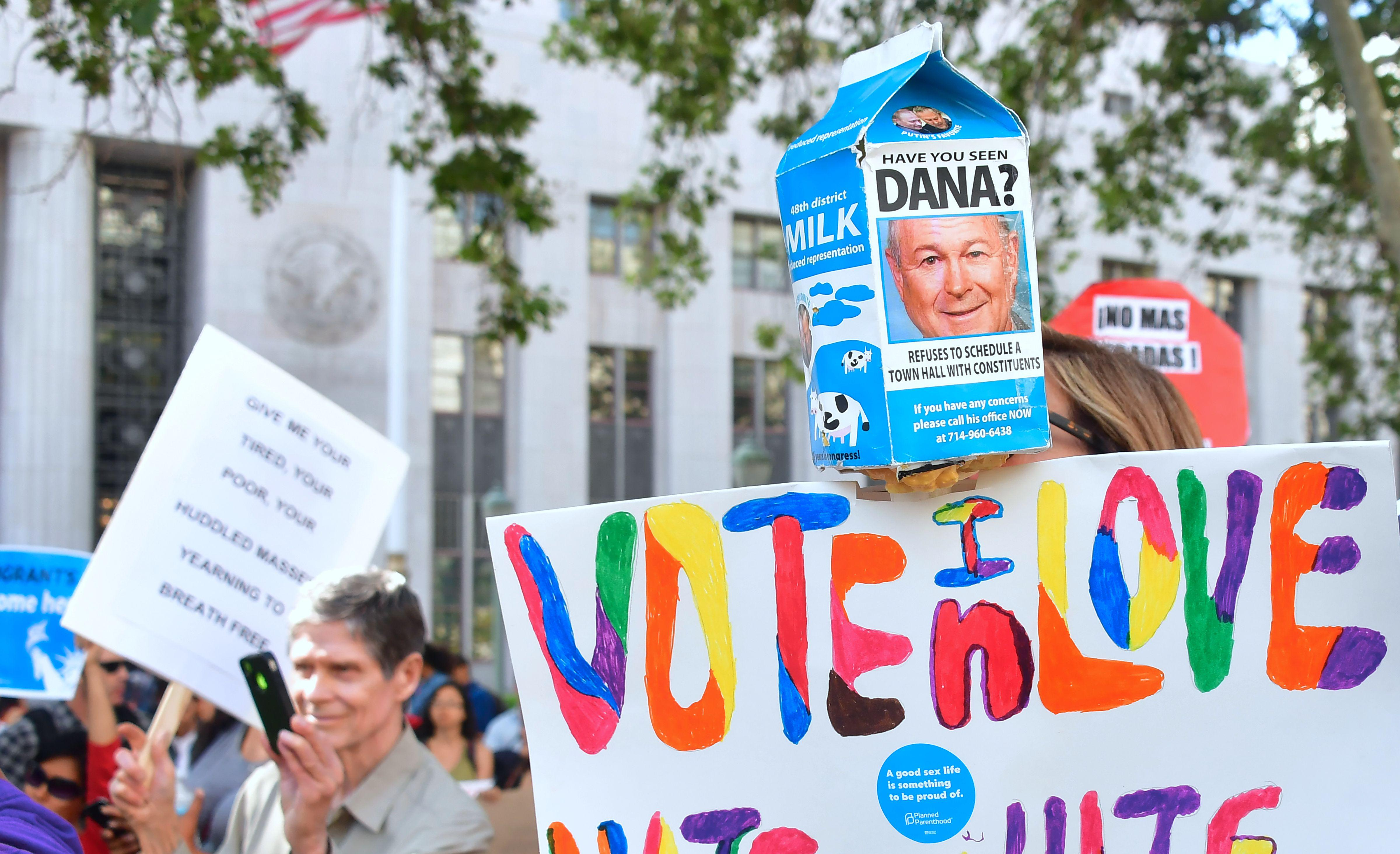 "A protest sign reads ""HAVE YOU SEEN DANA?"" criticizing the Republican for refusing to meet with constituents."