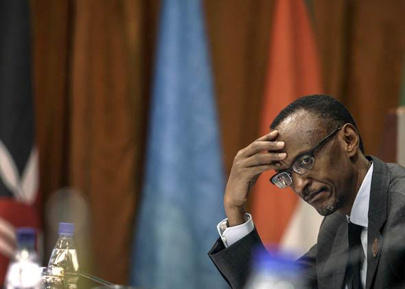Rwanda's President Paul Kagame listens to deliberations during the International Conference on the Great Lakes Region (ICGLR) in the Ugandan capital of Kampala August 8, 2012.