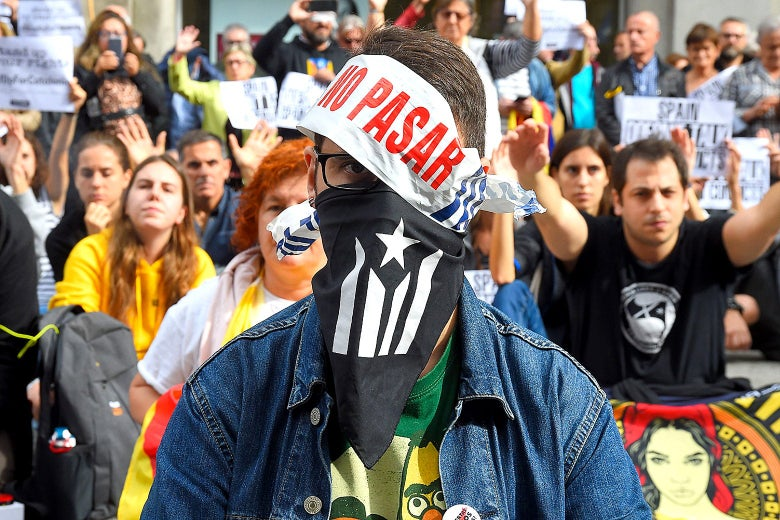 A masked demonstrator in Barcelona on Wednesday.
