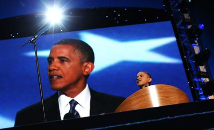 President Barack Obama speaks on stage as he accepts the nomination for president.
