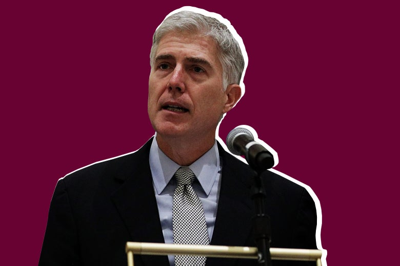 Supreme Court Justice Neil Gorsuch speaks at a podium.