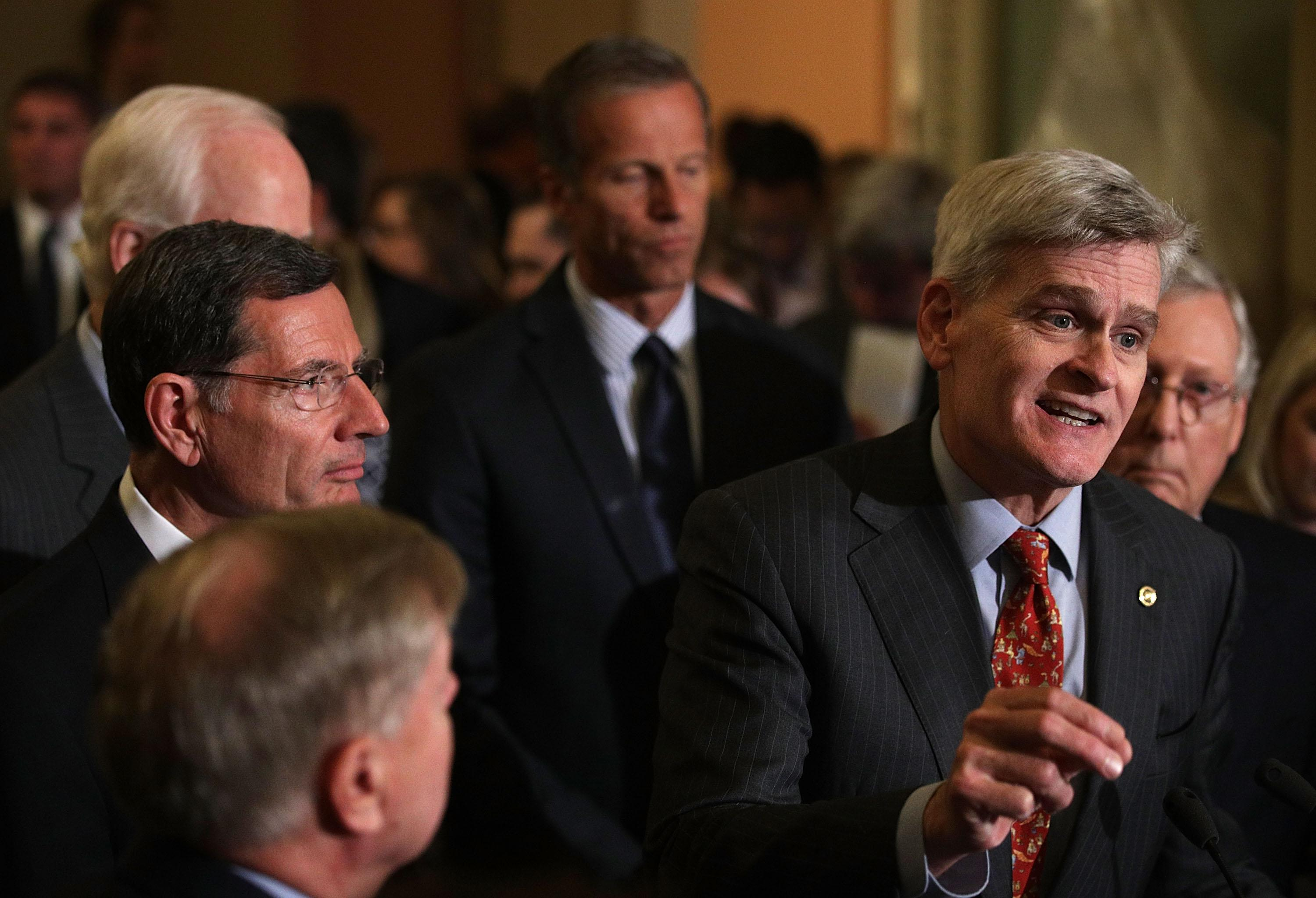 WASHINGTON, DC - SEPTEMBER 19:  U.S. Sen. Bill Cassidy (R-LA) (2nd R) speaks as (L-R) Sen. Lindsey Graham (R-SC), Sen. John Barrasso (R-WY), Sen. John Thune (R-SD), and Senate Majority Leader Sen. Mitch McConnell (R-KY) listen during a news briefing after the weekly Senate Republican policy luncheon at the Capitol September 19, 2017 in Washington, DC. Senate Republican held a weekly policy luncheon to discuss GOP agenda.  (Photo by Alex Wong/Getty Images)