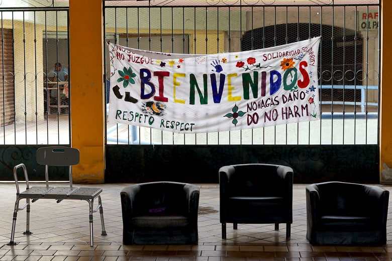 "A hand-painted banner reads, ""Bienvenidos."""