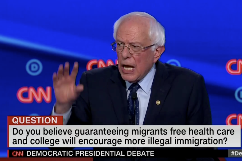 "In this screengrab from CNN, Bernie Sanders debates. The banner reads: ""Do you believe guaranteeing more migrants free health care and college will encourage more illegal immigration?"""