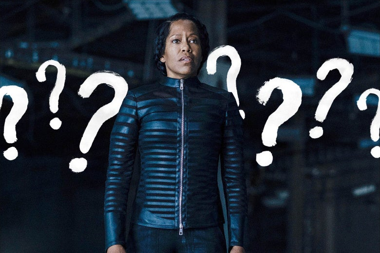 Regina King, in costume as Angela Abar from Watchmen, stands in a warehouse looking confused. Giant question marks are drawn all over the background.