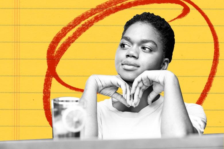 A black woman sits at a bar, waiting.