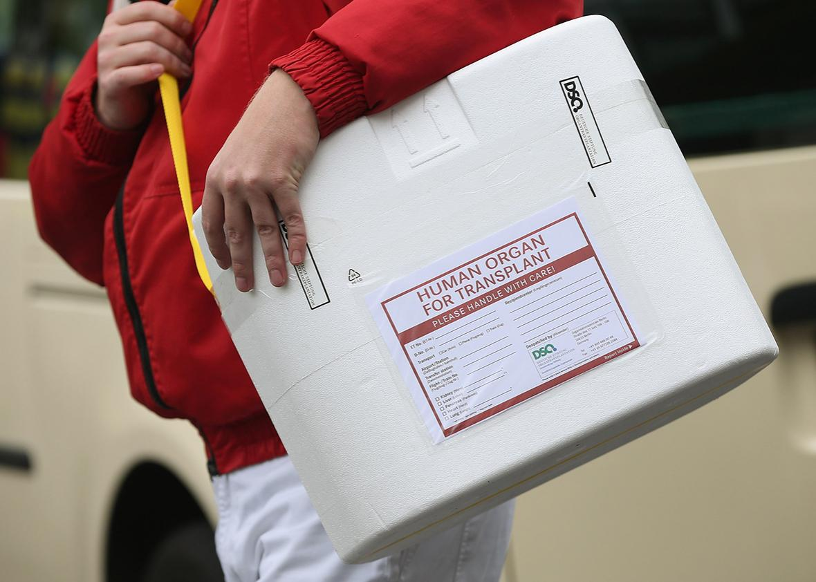 A driver carries an empty styrofoam box used for transporting human organs to his van at the Vivantes Neukoelln clinic on September 28, 2012 in Berlin, Germany.
