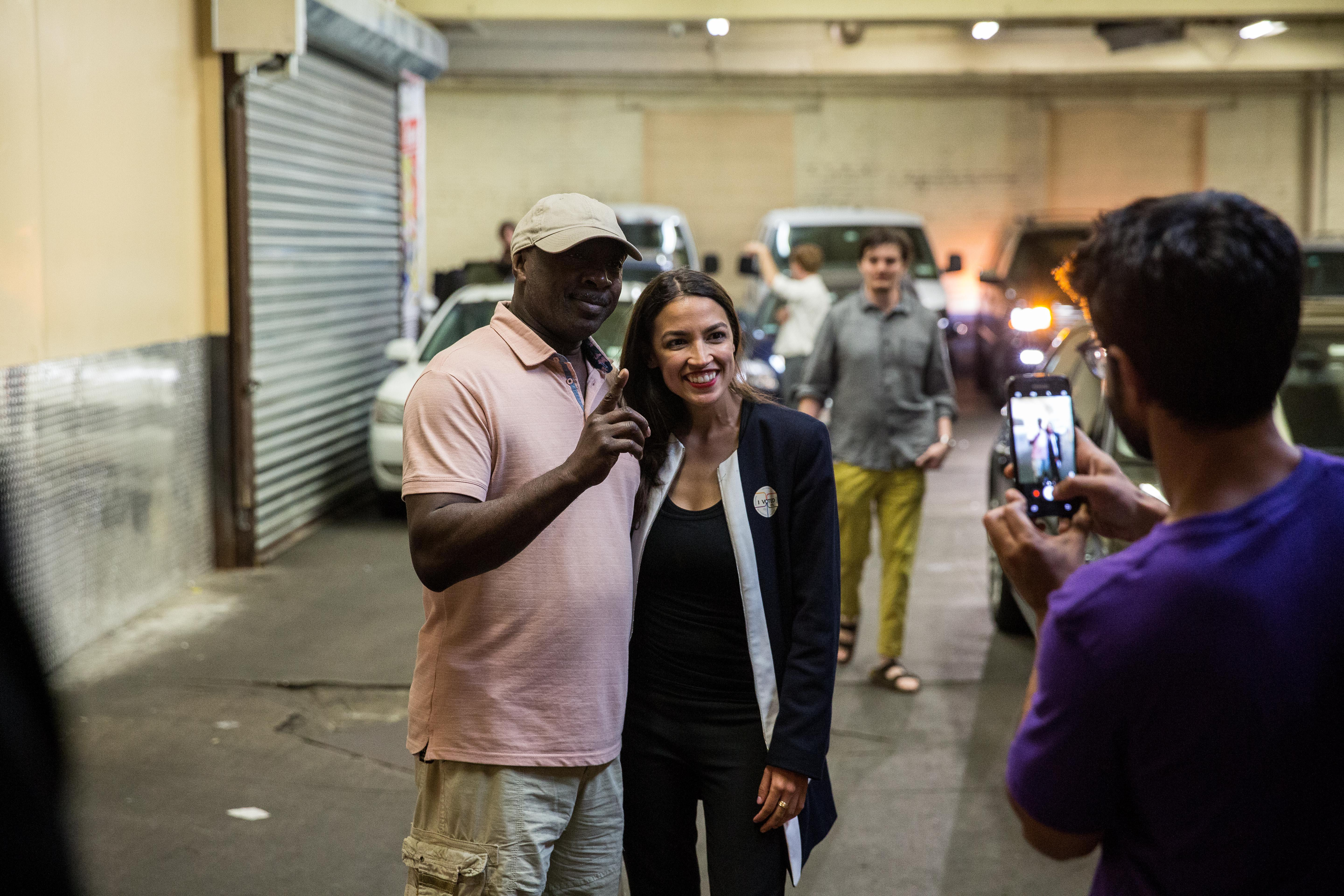 Alexandria Ocasio-Cortez celebrates with supporters at a victory party in the Bronx.