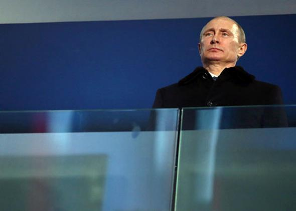 Vladimir Putin the President of Russia watches the Opening Ceremony of the Sochi 2014 Paralympic Winter Games.