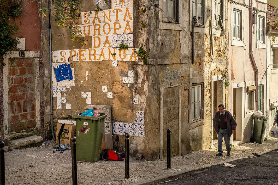 "A tile painting in Lisbon, Portugal, in 2013 says ""Holy Europe of Hope"" with euro symbols."