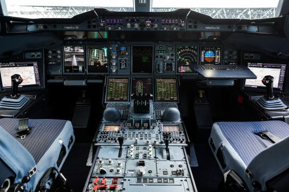 Air traffic controllers call up pilots to give them instructions, inquire about their intentions, and relay information. Above, the cockpit of an Airbus A380 in 2012.