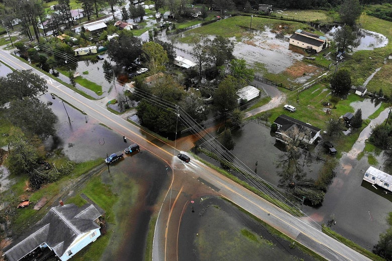 An aerial image of flooded roads and houses.