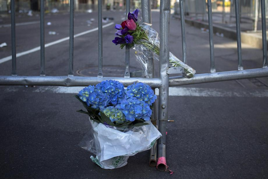 Flowers are seen at the barricaded entrance at Boylston Street near the finish line of the Boston Marathon in Boston.