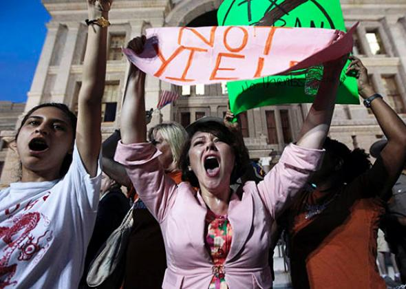 Pro-choice protester Julia Ann Nitsch, center, chants during a rally at the Texas state capitol over controversial abortion legislation in July 2013 in Austin, Texas