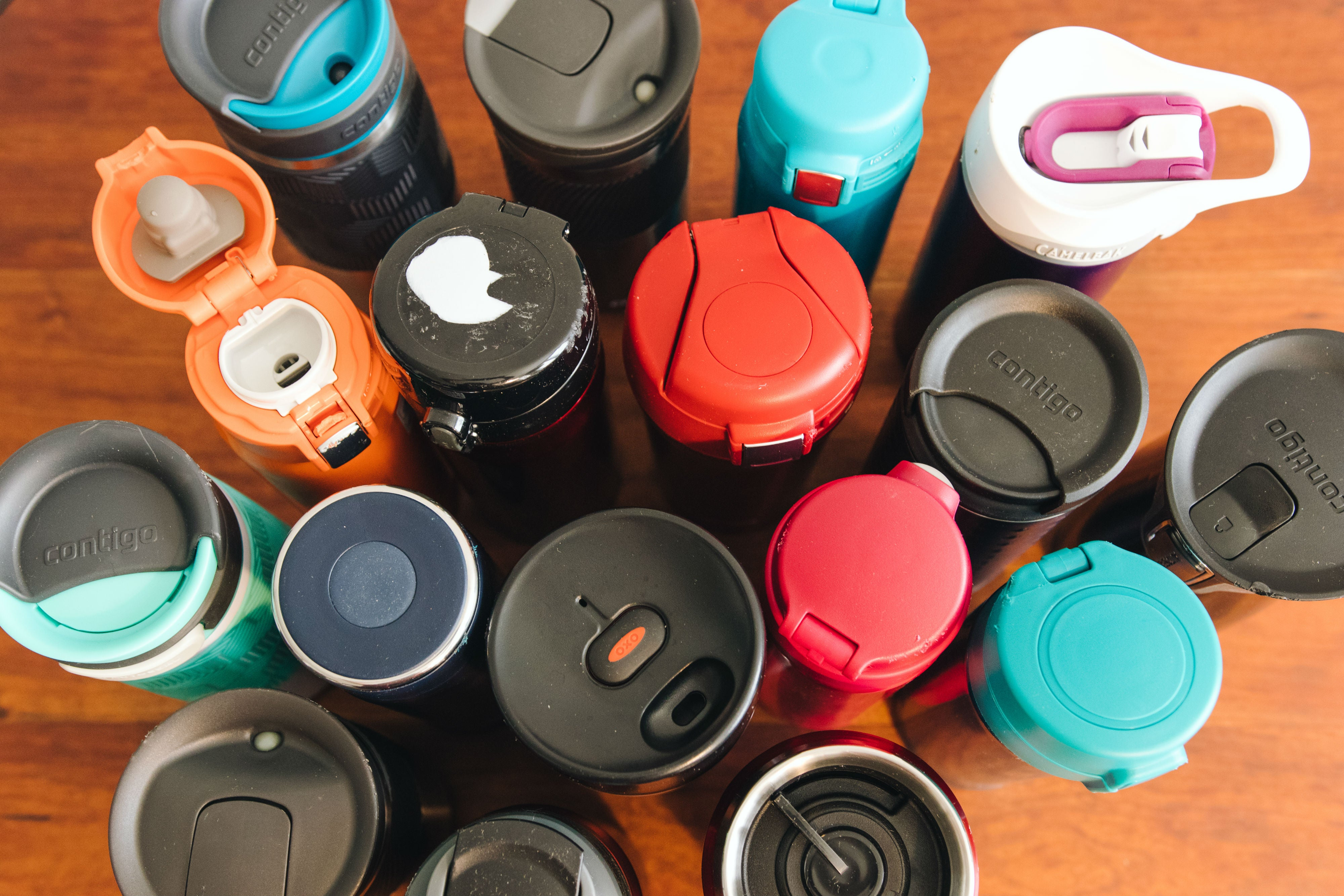 a group of travel mugs