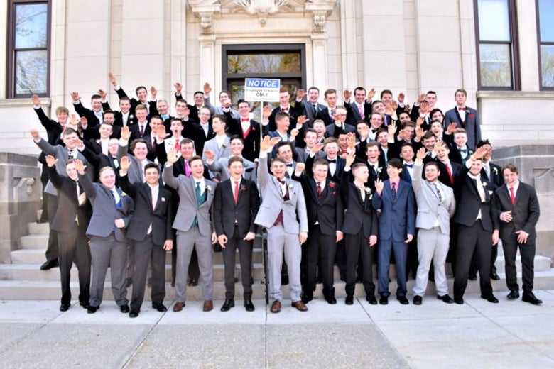 Baraboo High School boys make what appear to be Nazi salutes in a group photo.