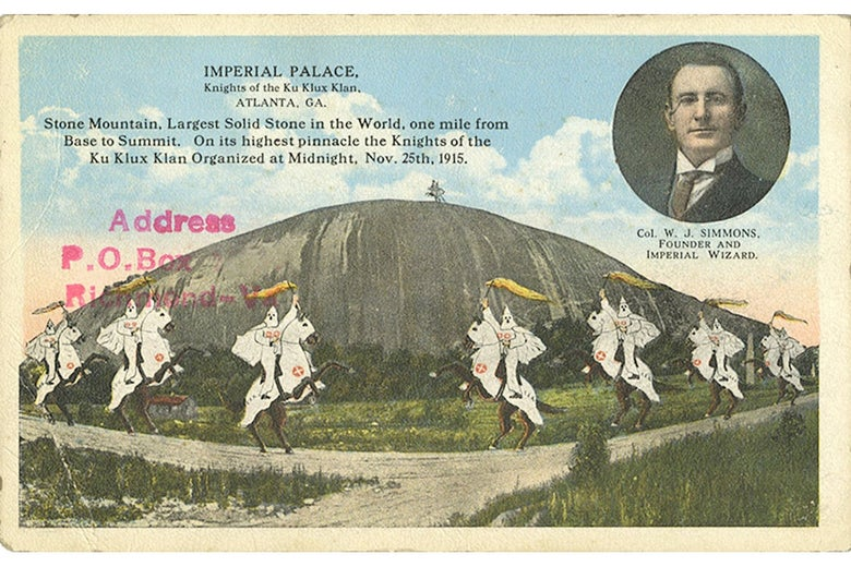 A KKK postcard depicting Klansmen riding in front of Stone Mountain.