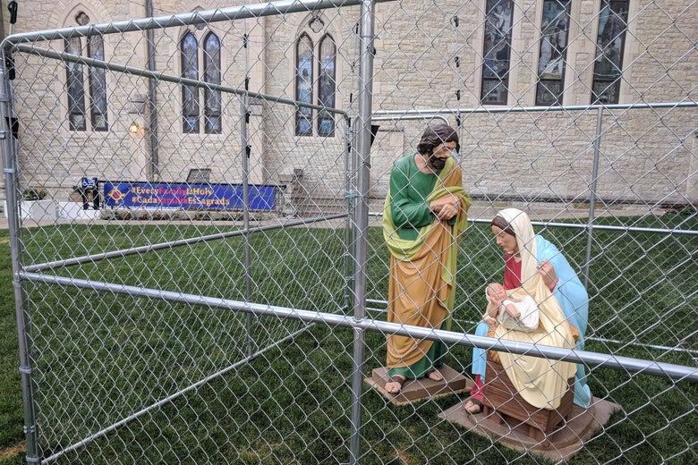 The statues of Jesus, Mary, and Joseph are seen in a cage as a protest of child separation policy, in Indianapolis, Indiana on July 2, 2018.