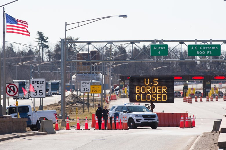 "A sign reading ""U.S. border closed"" in front of a checkpoint."