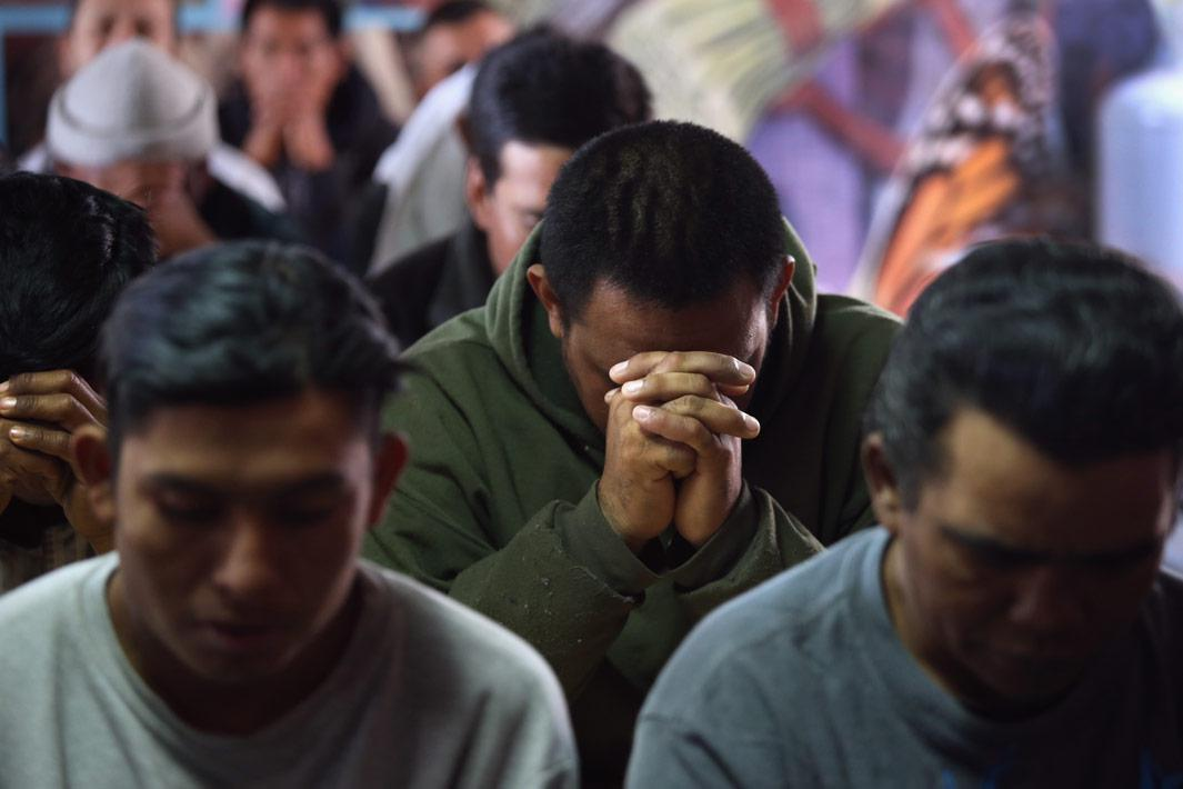 Nogales, Mexico Immigrants pray during a Catholic Mass held at the Kino Border Initiative center for migrants March 10, 2013 near the U.S.-Mexico border in Nogales, Mexico. The center feeds hundreds of meals per day to immigrants recently deported from the United States and those about to attempt to cross into the U.S. illegally.