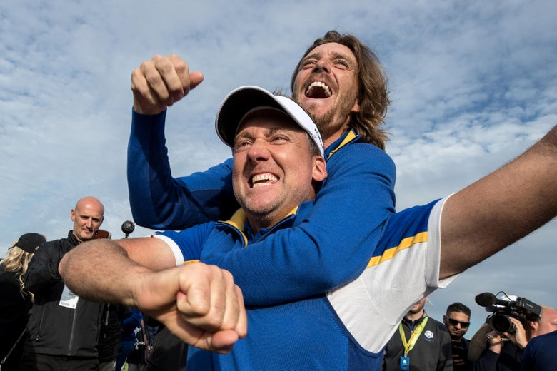 Fleetwood jumping onto Poulter's back with a big open-mouthed grin, Poulter smiling and pumping his fists in celebration
