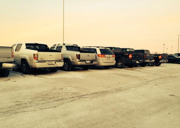 Sarah Kovaleski's minivan parked among pickup trucks.