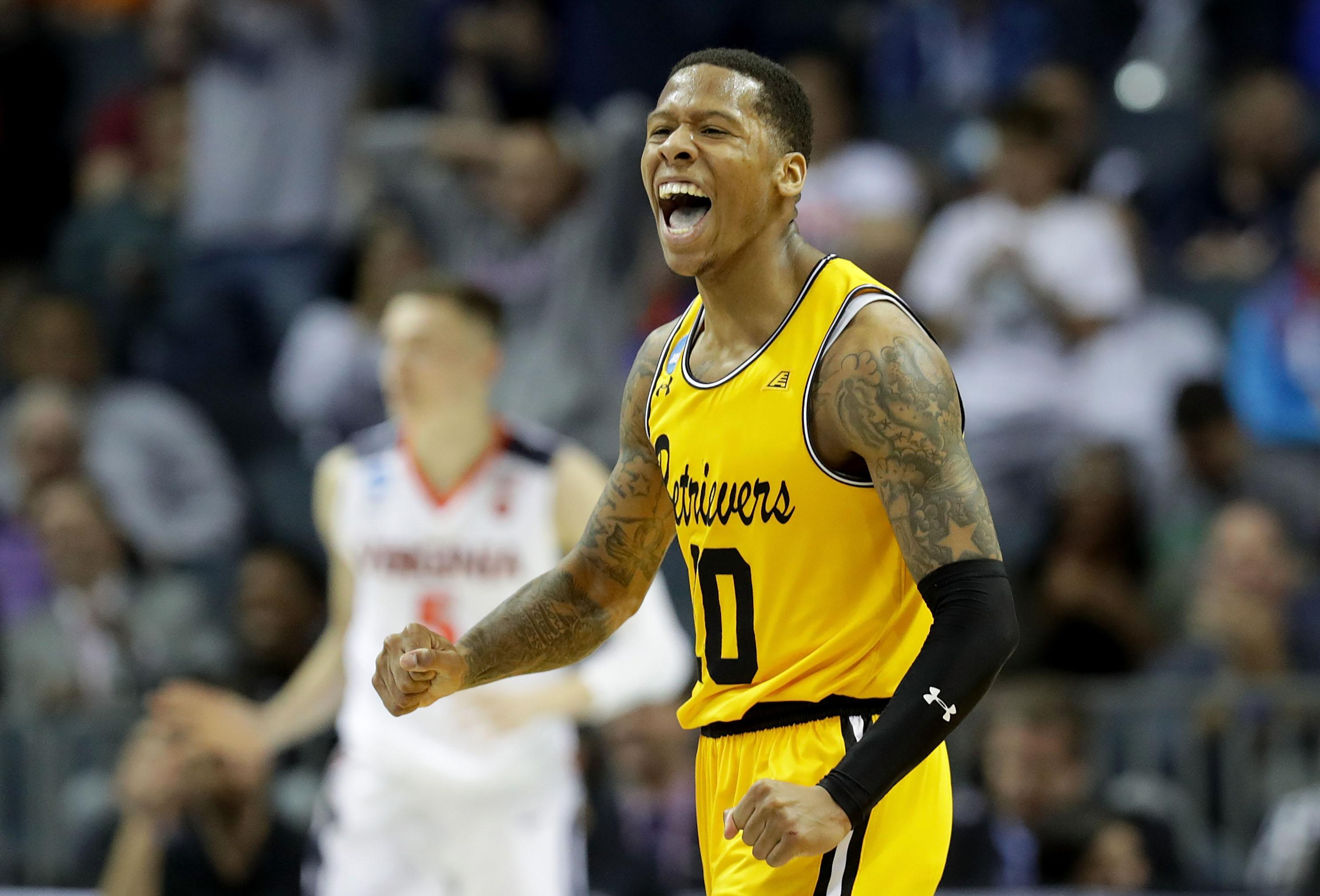 CHARLOTTE, NC - MARCH 16:  Jairus Lyles #10 of the UMBC Retrievers reacts after a score against the Virginia Cavaliers during the first round of the 2018 NCAA Men's Basketball Tournament at Spectrum Center on March 16, 2018 in Charlotte, North Carolina.  (Photo by Streeter Lecka/Getty Images)
