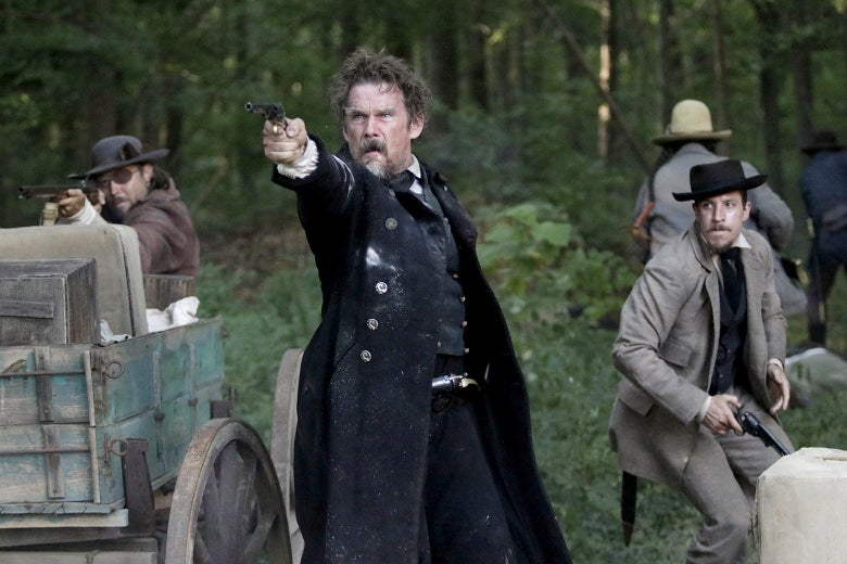 Ethan Hawke, playing John Brown, points a gun in The Good Lord Bird.