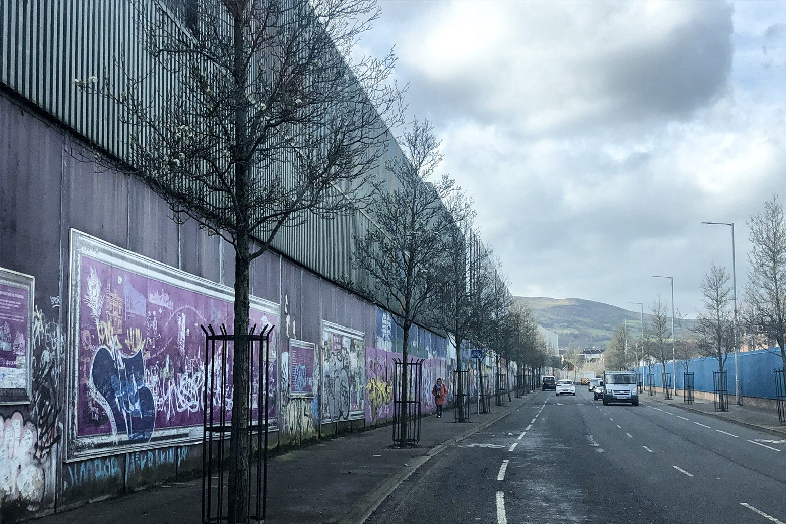 A grafitti-covered steel and concrete wall.