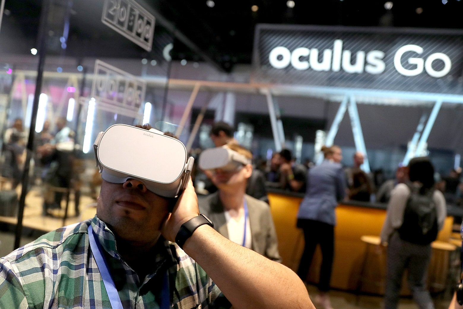 Attendees use the Oculus Go virtual reality headset during the F8 Facebook developers conference on Tuesday in San Jose, California.