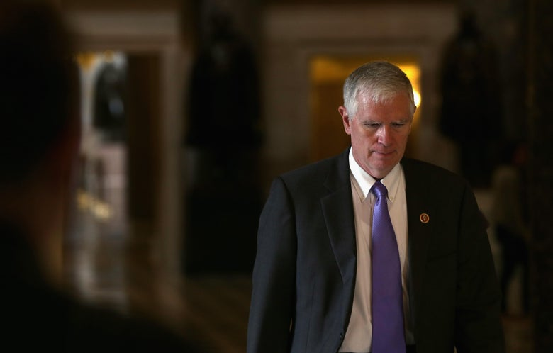 "Mo Brooks throws his eyes down while walking in the Capitol. ""Srcset ="" https://compote.slate.com/images/f1fdbdab- b435-4561-a5f5-296ecb0bb593.jpeg? width = 780 & height = 520 & rect = 4381x2921 & offset = 623x271 1x, https://compote.slate.com/images/f1fdbdab-b435-4561-a5f5-296ecb0bb593.jpeg?width=780&height=520&rect = 4381x2921 and offset = 623x271 2x"