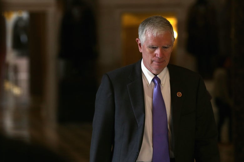 Mo Brooks casts his eyes downward as he walks in the Capitol.