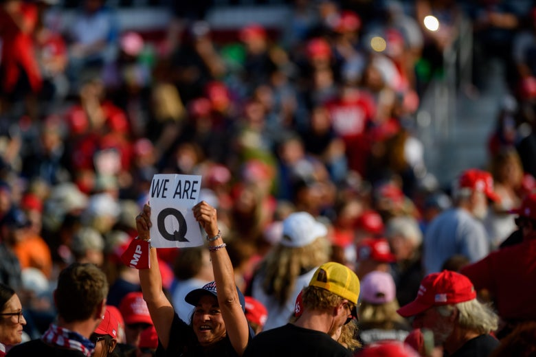 A person holds up a QAnon sign amid the crowd at a Trump rally on Sept. 22.