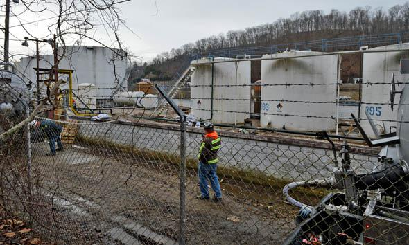Leaking MCHN tanks at Freedom Industries are being off loaded into tanker trucks on January 10, 2014  in Charleston, West Virginia.