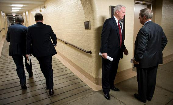 Rep. Paul Broun, R-Ga., and Rep. Joe Wilson, R-S.C., talk as they leave the House Republican Conference meeting in the Capitol.