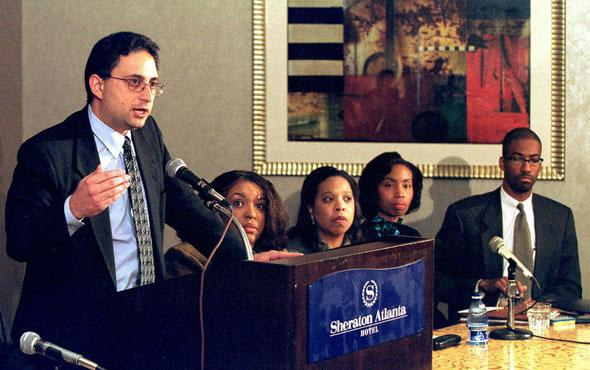 Lead defense attorney Cyrus Mehri (L) talks at a press conference announcing the racial discrimination settlement with Coca-Cola in Atlanta, 16 November 2000.