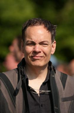 Broadcaster Max Keiser addresses media and protesters in the protester encampment.