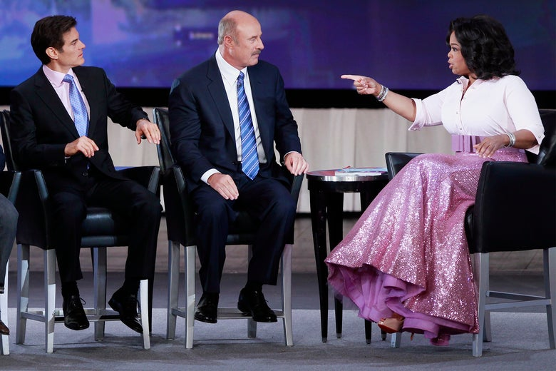 Dr. Oz, Dr. Phil, and Oprah Winfrey at Radio City Music Hall in New York City in 2010.